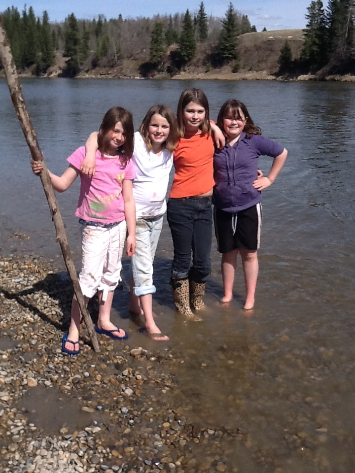 Paris, Erika, Jasmine and Paris playing by the Red Deer River