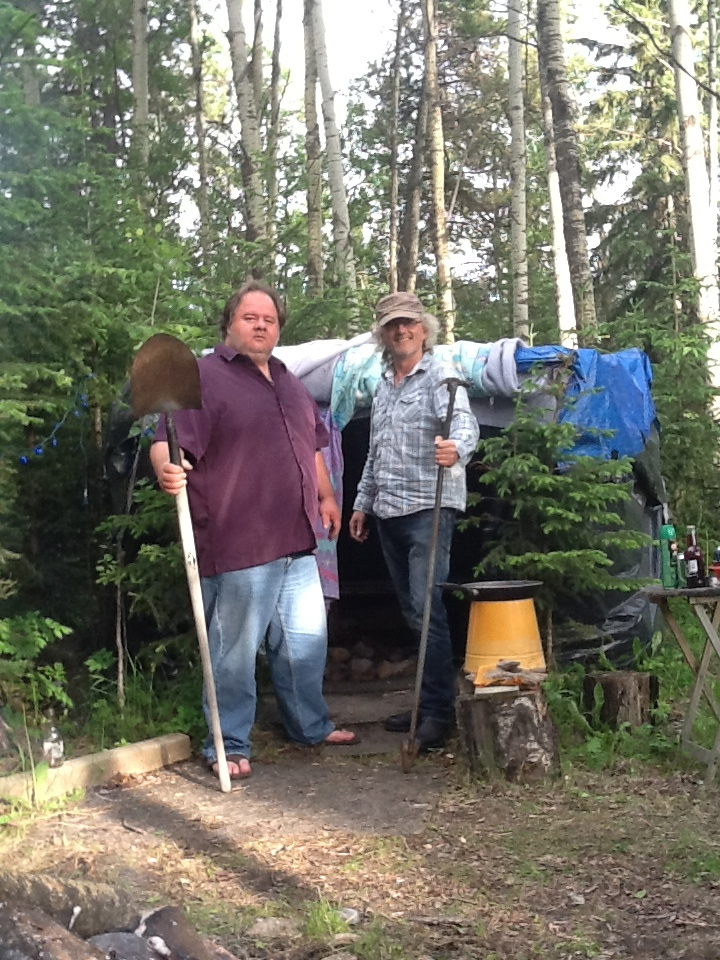 Tom and Frank preparing the hut in Rocky Mountain House