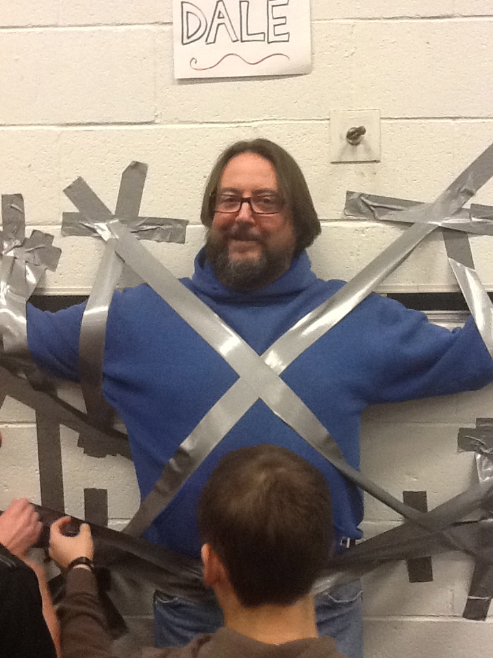 Mr Dale being taped to the wall for Tape the Teacher