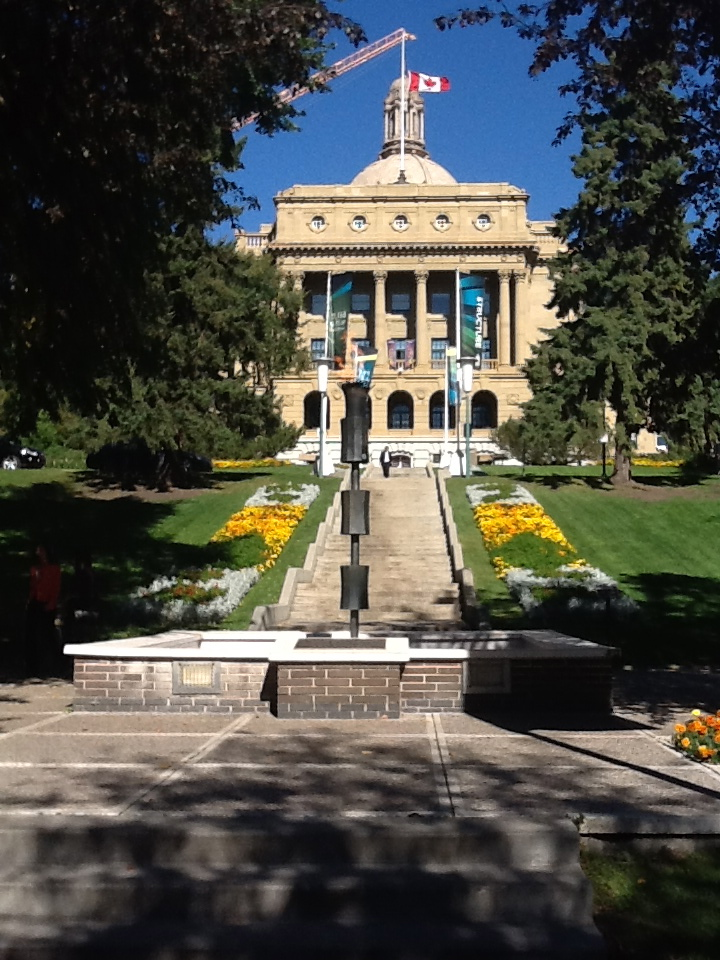 The Eternal Flame at the Alberta Legislature with the flag at half mast for Peter Lougheed