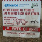 Spring Street Sweeping Sign