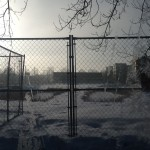 Frosty Fence and Snowy Lot