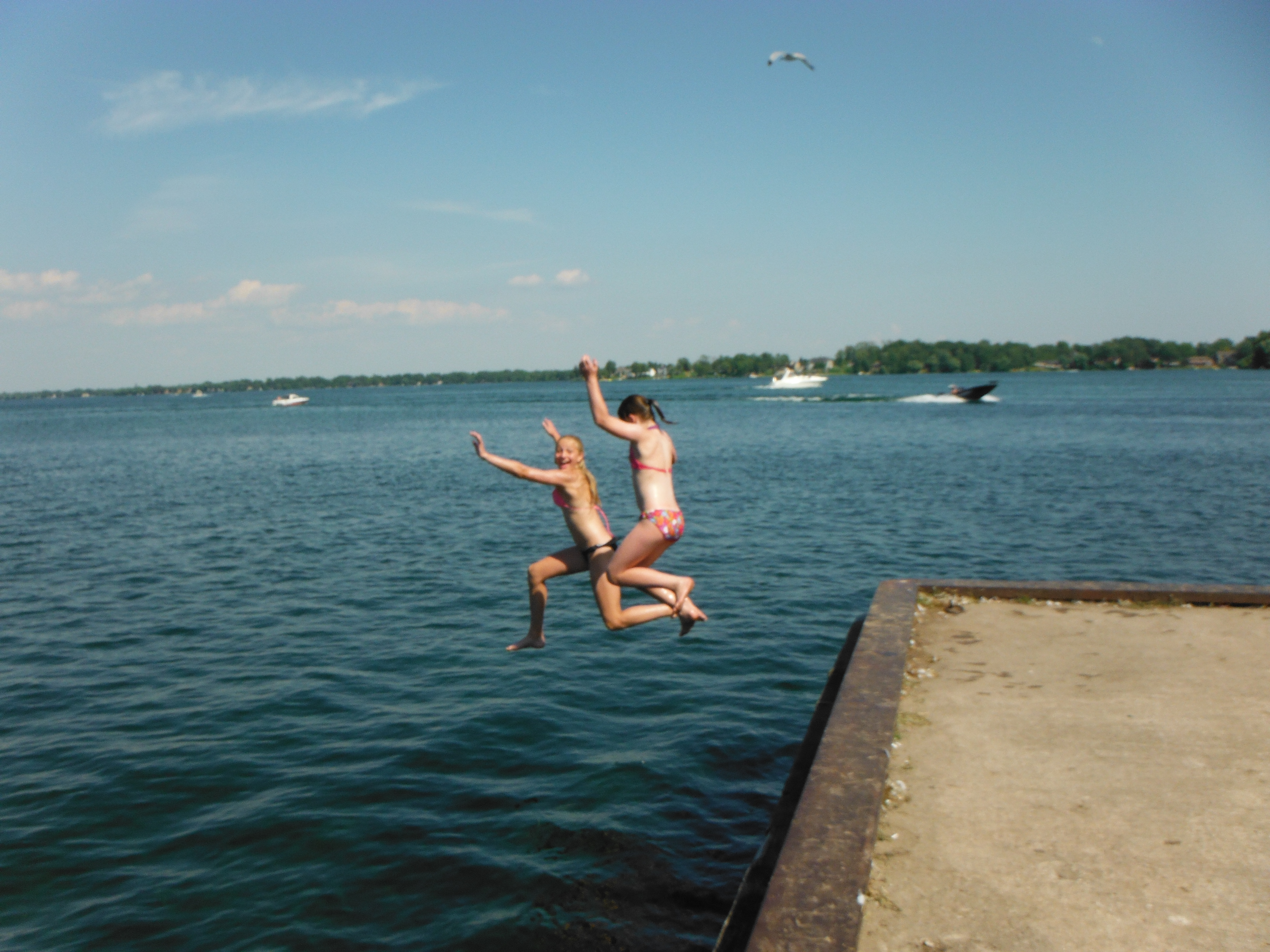 Paris and Kendall jumping off the dock into Lake Couchiching in Orillia Ontario