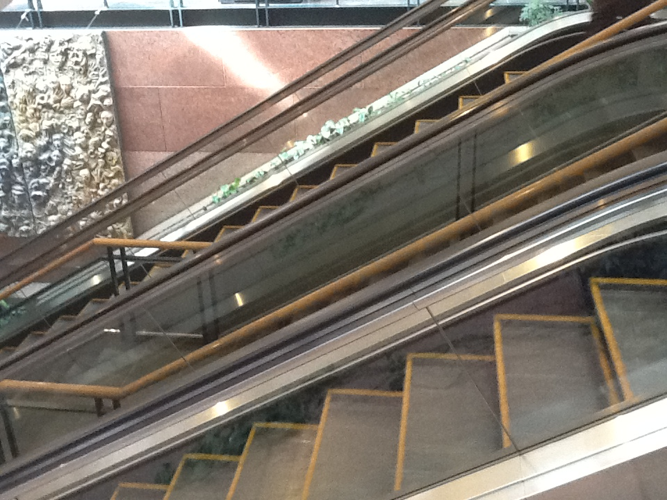 Staircase flanked by escalators at Commerce Place