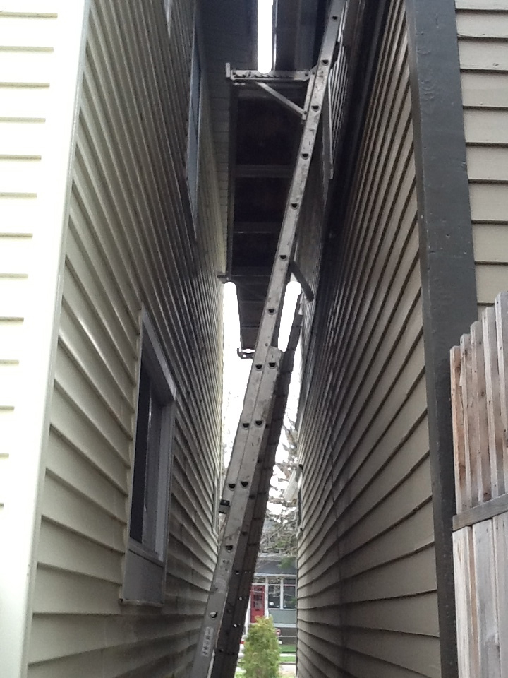 Beneath the scaffolding between the houses