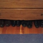 Shoes beneath the dresser