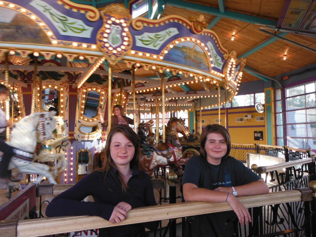 Jasmine and Paris in front of the carousel