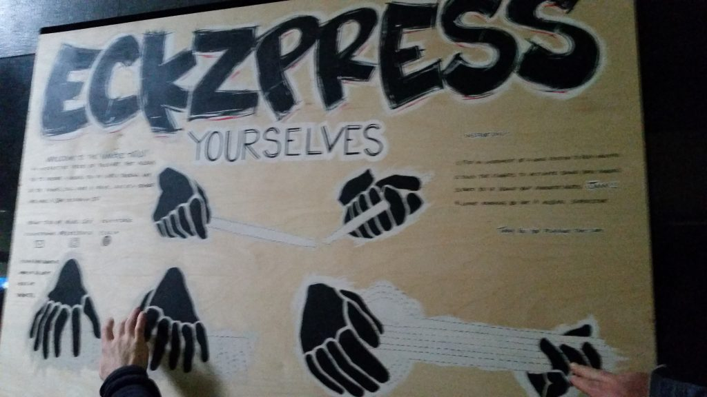 Eckzpress Yourselves Haptic Sign